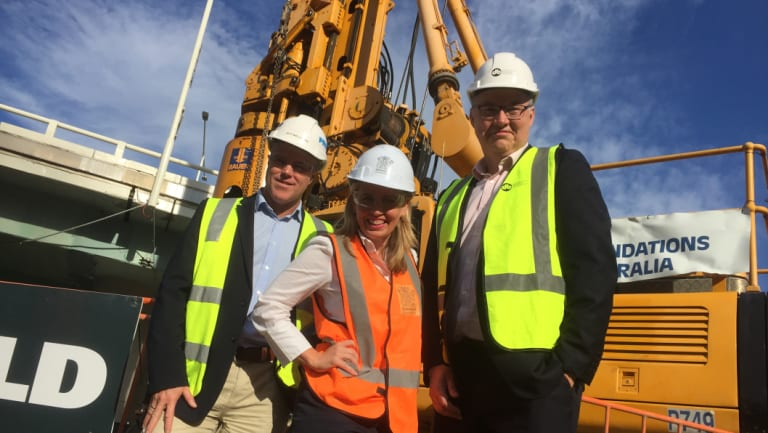Work on the waterproof bund wall around Brisbane new casino begins, watched by ProBuild managing director Jeff Wellburn, Tourism Minister Kate Jones and project director Simon Crooks.