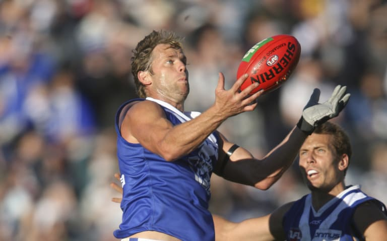 Glenn Archer in his playing days with North Melbourne.