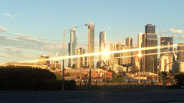 Building glare on the Melbourne skyline skyscrapers.