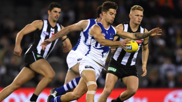 Kangaroos Jy Simpkin in action when North  thrashed Collingwood.