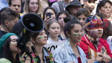 Swedish activist and student Greta Thunberg, centre, takes part in the Climate Strike in Montreal on September 27.