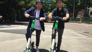 Lime's head of government relations Mitchell Price (left) and operations manager Ian Brouckaert with the Generation 3 scooter in Brisbane.