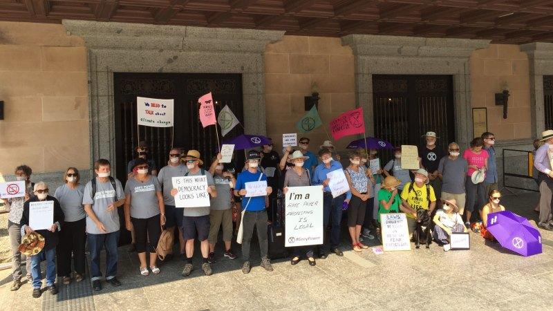 Senior activists tape mouths shut protesting Brisbane library ban