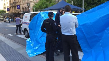 Police set up tarpaulins to shield the protesters from public view.
