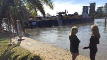 Deputy mayor Krista Adams and Bicycle Queensland chief executive Anne Savage at the City Botanic Gardens inspect the barge being used for the riverwalk construction.