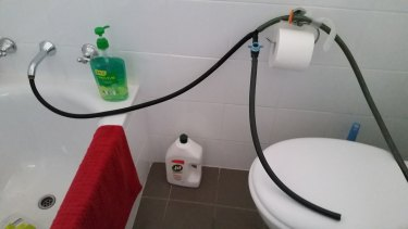 A home-made bidet to avoid the toilet paper queues.
