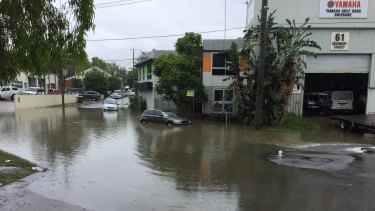 Flash flooding on Didsworth Street, South Brisbane, after heavy rain on Thursday morning.