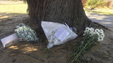 Tributes left outside the Scarborough home.