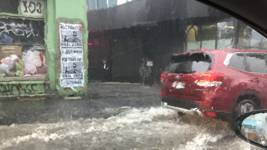 A car floating in the Dudley street underpass.
