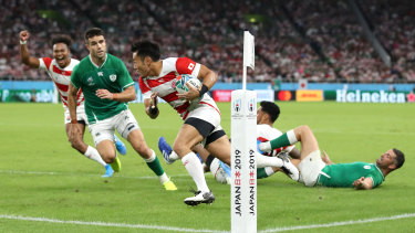 Super sub: Fukuoka crosses the try line to give Japan their first try.