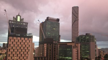 A strange orange glow enveloped the Brisbane CBD on Friday as dark clouds lingered.