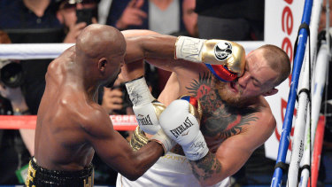 Pay day: Floyd Mayweather Jnr gets in the face of Conor McGregor. He won in a 10th-round stoppage in Las Vegas.
