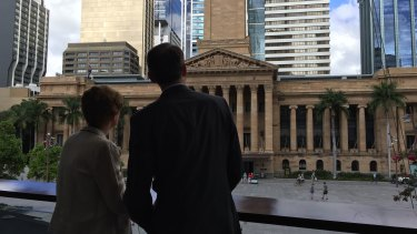 Outgoing Brisbane lord mayor Graham Quirk and his wife Anne look back at City Hall on the morning he announced he was stepping down from council.