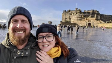 Australians Ben Goodwin and Amy Webster had their tickets on a Qatar flight cancelled because of the passenger cap reduction.