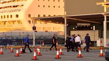 Investigators enter the cruise ship terminal at Hamilton in April.