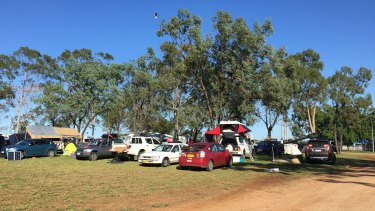 About 250 cars, camper vans and trailers parked overnight in the Clermont Showgrounds for the final Queensland Stop Adani rally.