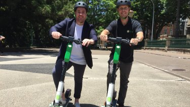 Lime's head of government relations Mitchell Price (left) and operations managerIan Brouckaert with the Generation 3 scooter in Brisbane.