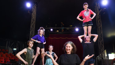 The Flying Fruit Fly Circus' artistic director Anni Davey with students (from left) Roscoe Harris-Westman, 14, Aysha Witt, 11, Nico Pope, 13 and Fidel Lancaster-Cole, 15, with Nell Finch, 14, on shoulders.