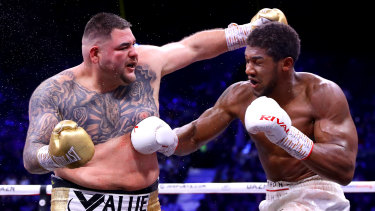 Anthony Joshua gets inside Andy Ruiz Jr during the IBF, WBA, WBO and IBO title bout at the Diriyah Season.