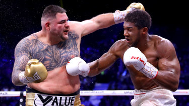 Anthony Joshua connects with a body shot on Andy Ruiz.