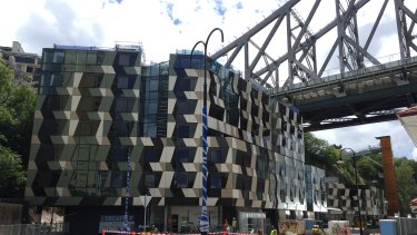 New five-star hotel looks like a deck of playing cards under the Story Bridge. It opens in March 2019.
