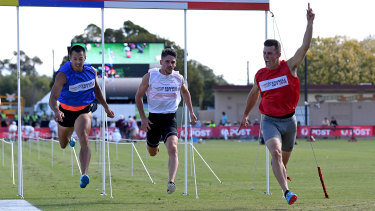 Jacob Despard (far right) crosses the finish line to win the 2018 Stawell Gift.
