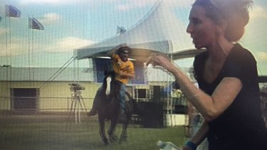Video taken by an anti-Adani protester of a man riding a horse through Clermont showground.