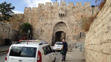 My father (right) approaching St Stephen's Gate, also known as the Lions' Gate, one of the entrances to Jerusalem's Old City in the occupied east of the capital.