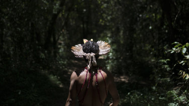 Hayo, chief of the Pataxo Ha-ha-hae indigenous community, walks toward the Paraopeba River days after the collapse of a mining company dam near his village in Brumadinho, Brazil.