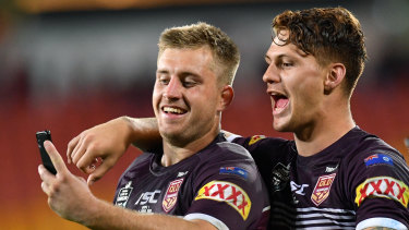 Pride of Queensland: Kalyn Ponga (right) and Cameron Munster take a happy snap at full-time.