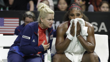 Pep talk: United States' captain Kathy Rinaldi counsels Serena Williams during a break in the match.