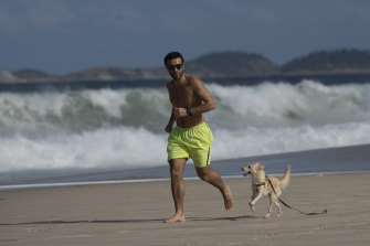 Beaches such as Copacabana are open for exercise but closed for sunbathing.