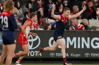 Tom McDonald celebrates one of his four goals for the Demons in their win over the Swans.
