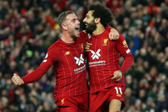 Liverpool's Jordan Henderson, left, and Mohamed Salah, right, celebrate a goal.