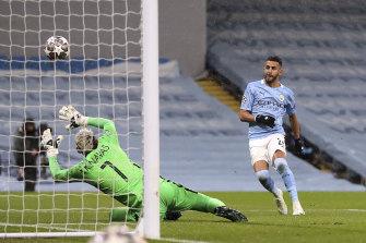 Riyad Mahrez scores City's second goal of the night.