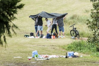Brief spells of rain dampened the mood at some of Sydney's picnics.