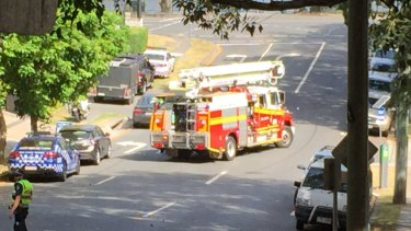 A fire truck enters Coronation Drive where two men remain holed up in a unit as police negotiate with them.
