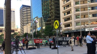 The protest was by a group calling themselves Extinction Rebellion South-East Queensland.