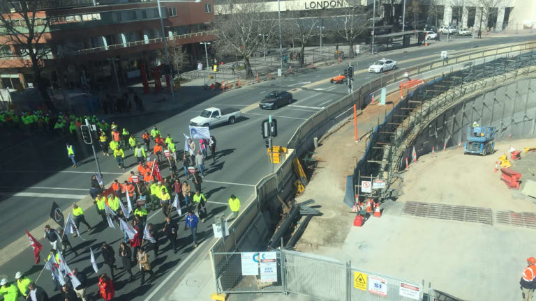 Union members march on the Assembly in support of a proposed local jobs code.