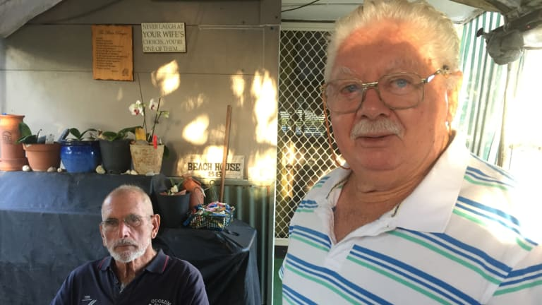 "Friendship and affordability keep Bob Davidson and mate Ken Cameron living in a beachside caravan park at Coolum. ""We couldn't go pay rent anywhere else."""