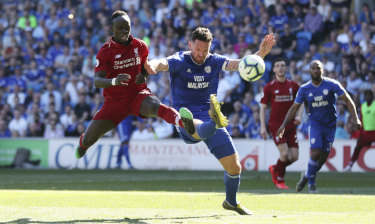 Liverpool's Sadio Mane and Cardiff City's Sean Morrison fight for the ball at Cardiff City Stadium on Sunday.