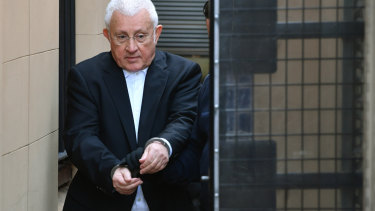 Ron Medich is escorted from court following his sentencing on Thursday.