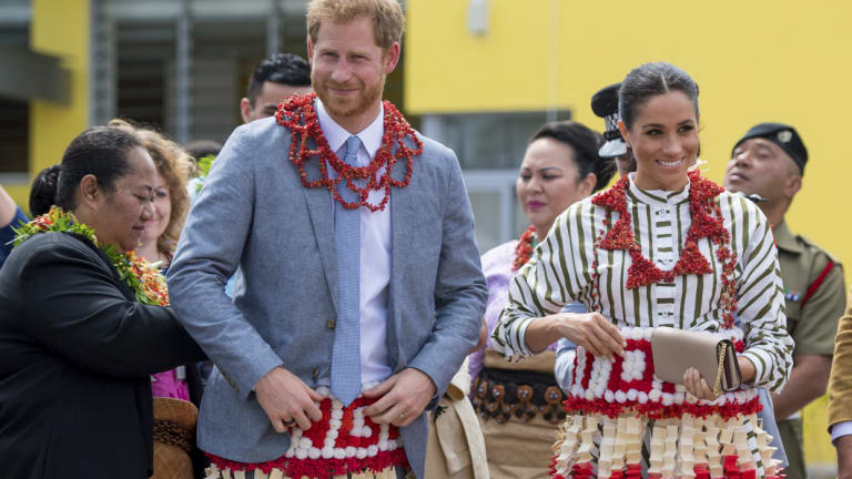 Britain's Prince Harry and Meghan, Duchess of Sussex wear a ta'ovala, a traditional Tongan dress wrapped around the waist, at the Fa'onelua Convention Centre in Nuku'alofa, Tonga.