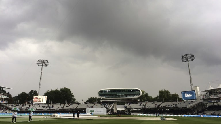 Nothing doing: Rain clouds hang above the pitch at Lord's.
