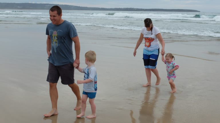 Toby Jamieson (left) at the beach with his son William, wife Linda and daughter Sophie in 2016.