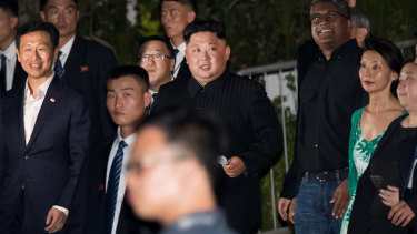 Kim Jong-un tours the Esplanade in Singapore on Monday night.