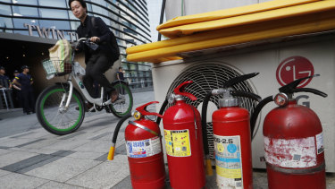 Fire extinguishers are placed near a building where the Japanese embassy is located in Seoul.