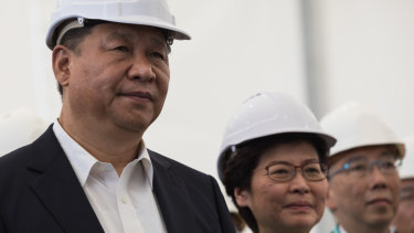 In the early days, Xi Jinping and Carrie Lam visit a section of the Hong Kong-Zhuhai-Macau bridge in Hong Kong in 2017.