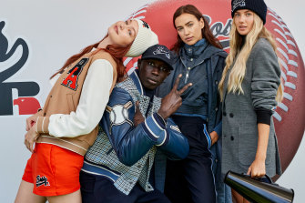 Gigi Hadid, TikTok performer Khaby Lame, Irina Shayk and German athleteAlica Schmidt at the Boss x Russell Athletic show, Milan Fashion Week.