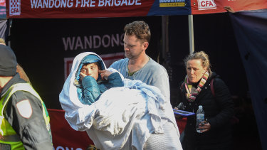 Will Callaghan, in his stepfather's arms, after being found. His mother Penny follows close behind.